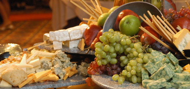 A collection of various fruits and cheeses