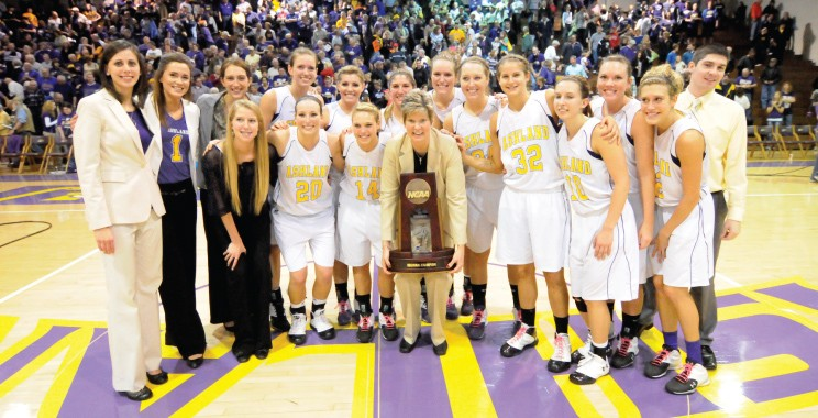 Girls Basketball team holding NCAA trophy