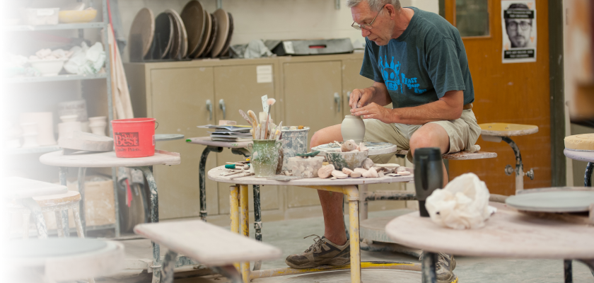 professor creating pottery