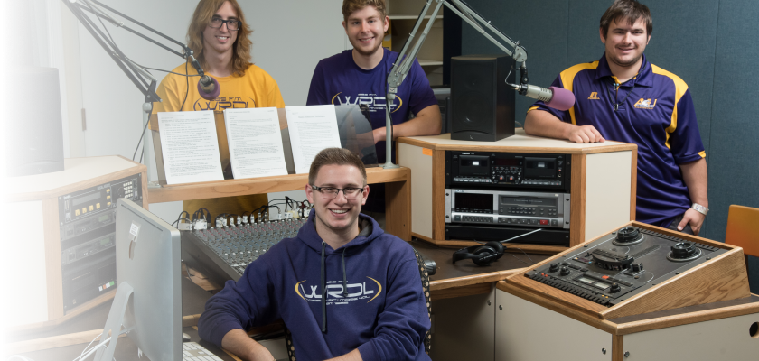 Students posing with radio equipment