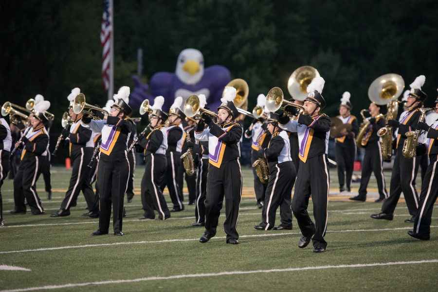 Ashland University Marching Band performing during a football game