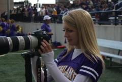 Halee Heironimus photographing football game