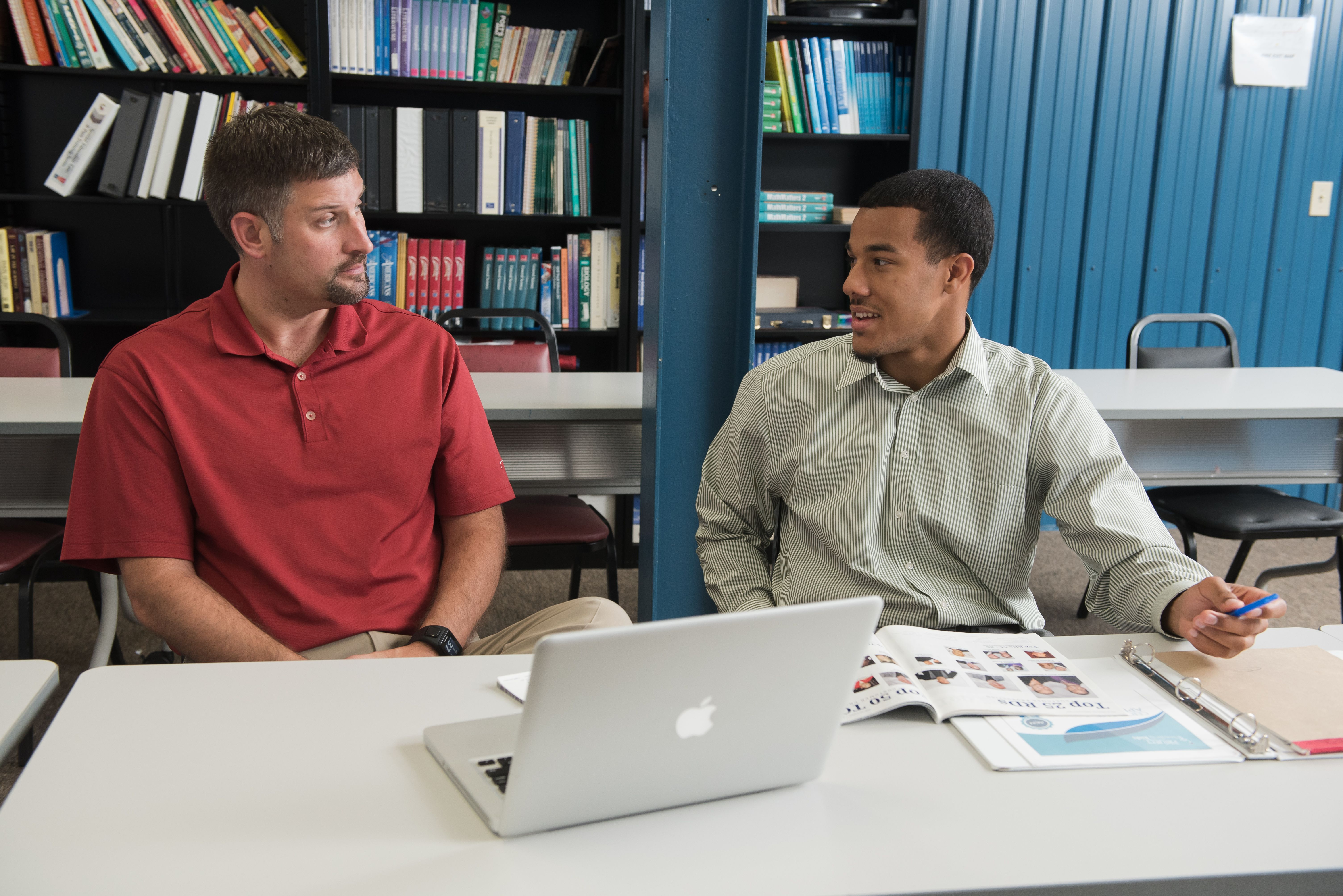 Student and professor discussing class work