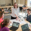 Image of an Interns student teacher working with a small group of students.