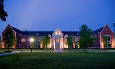 Image of the Dwight Schar College of Ed at night.