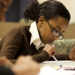 Find a class link image of a girl reading a textbook
