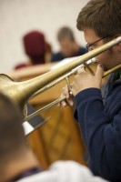 Music - Student Playing a Trombone