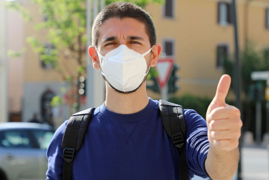 Stock photo of a male student wearing a medical mask