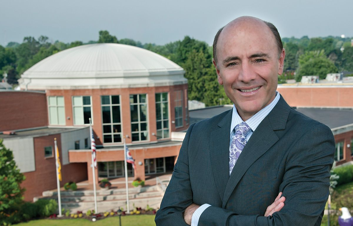 Dr. Campo in front of the Athletic Complex