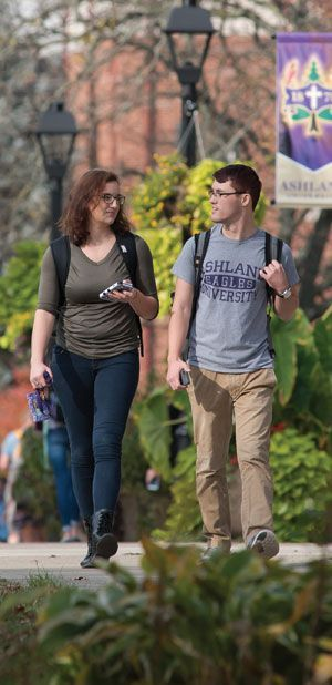 Male and Female student walking and talking on the Avenue of Eagles