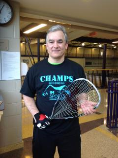 Champion Holding Racquetball Racquet
